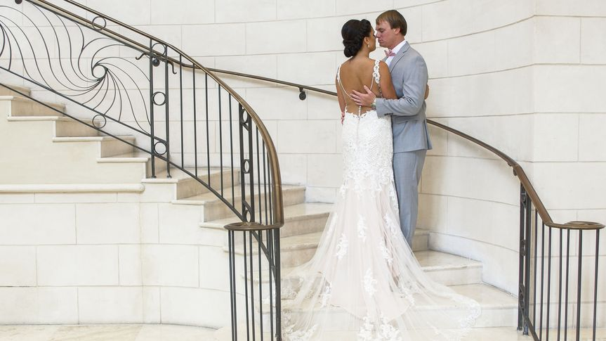 Bride and groom stair case shot