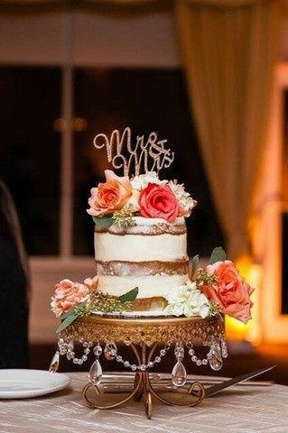 Naked cake with flower toppers