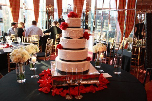 Classic white wedding cake with red & black accents.