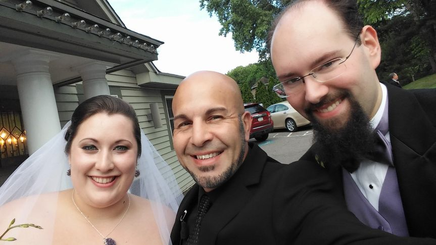 The officiant and the couple
