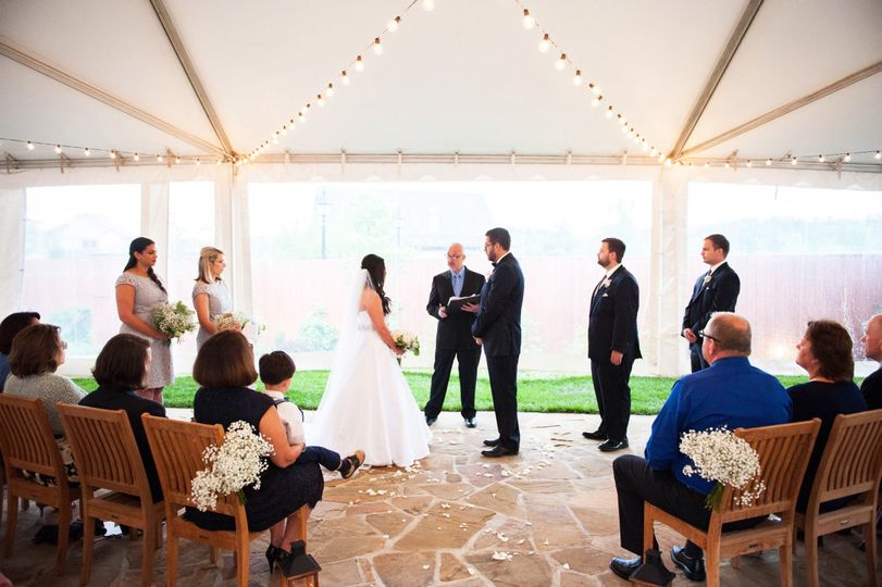 Beatiful tented wedding ceremony in Cedric's Gardens at The Biltmore in Asheville, NC.