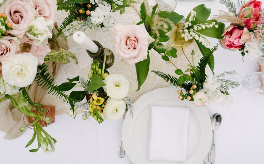 White table setup with flowers