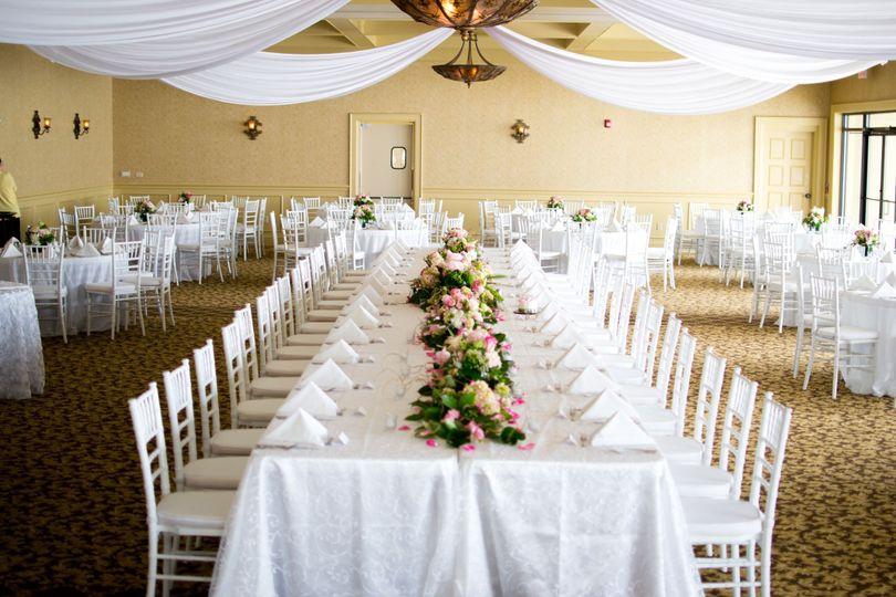 Beautiful white fabric draped over the head table