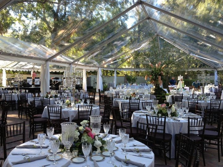 Clear top tents underneath old oak trees