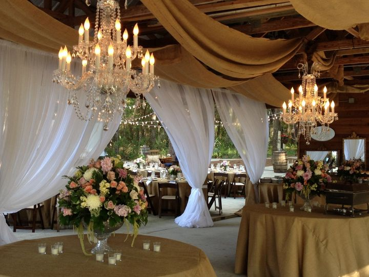 A combination of white sheers, burlap and crystal chandeliers.  It doesn't get any better than that!