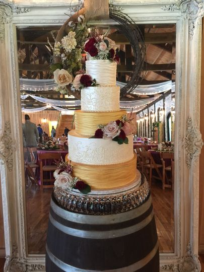 5-tier cake with gold tiers