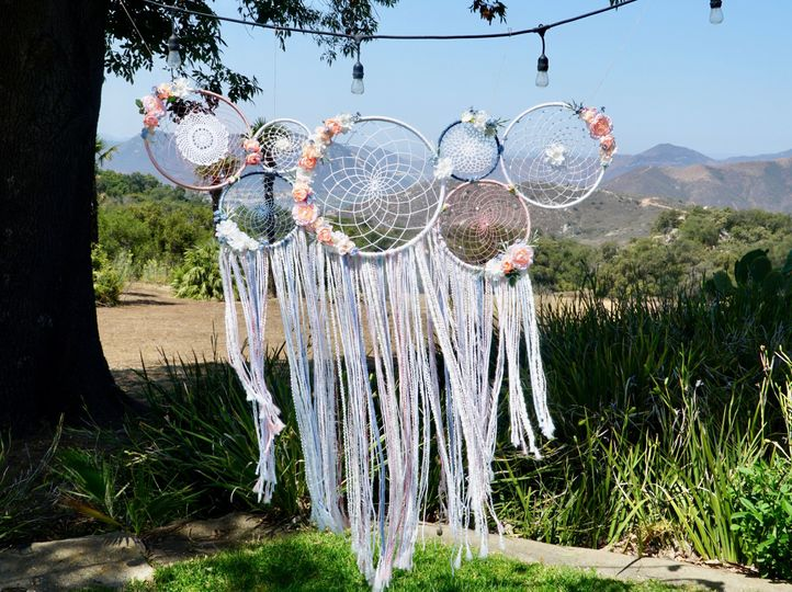 The perfect wedding back drop...this couple's colors were rose pink and blues with a boho chic...