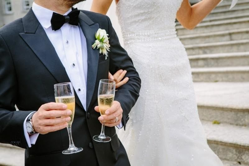 Groom holding champagne