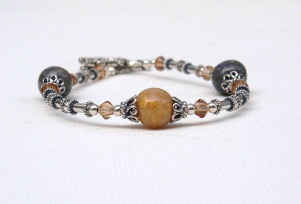 Real flowers were used to make the beads on this bracelet, which includes sterling silver Bali beads...