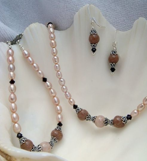 Flower petal jewelry set includes necklace, bracelet and earrings.  Dried flower petals were used to...