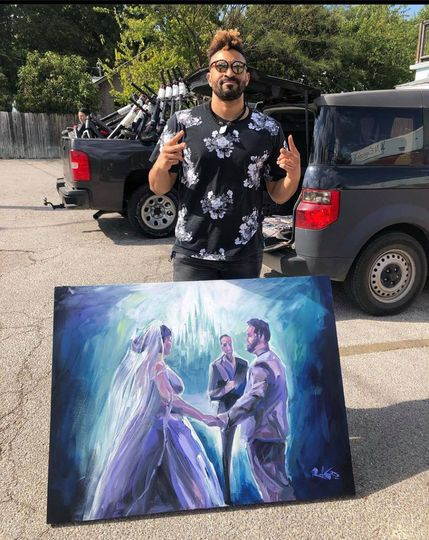 Proud artist w couple painting