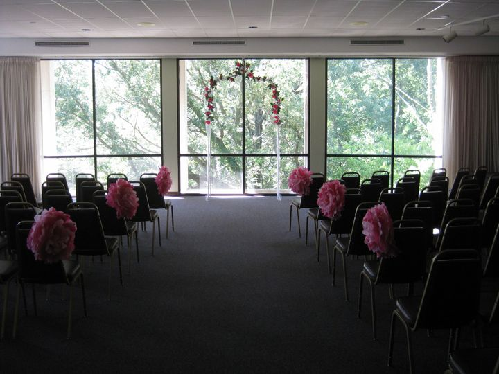 Beautiful wedding ceremony setup in the Salsbury Room at MacNider Art Museum. Minimal decorations...