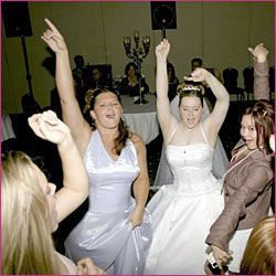 The bride dancing with their guests