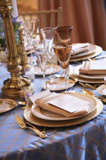 Table set up with golden spoon and fork