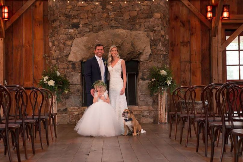 Newlyweds, flower girl, and their dog