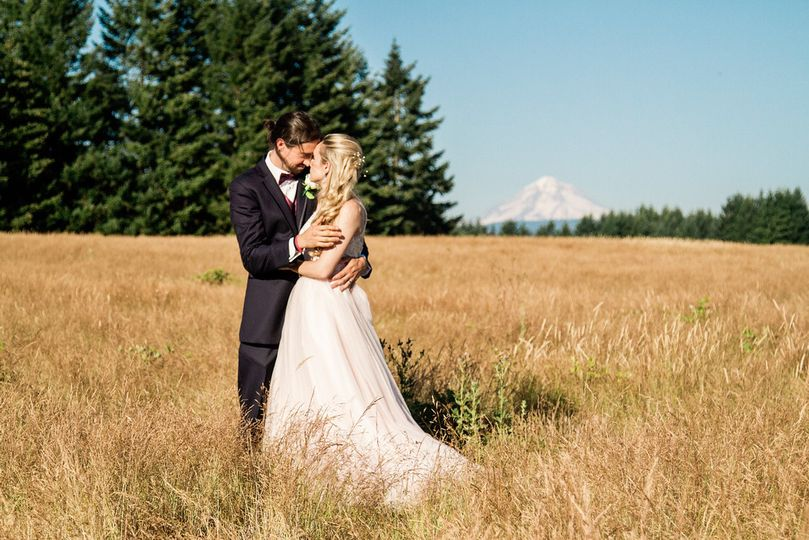 Todd and Emily celebrating their wedding with Mt Hood as the majestic backdrop.