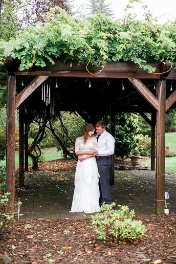 The wisteria covered arbor creates a romantic photo opportunity.