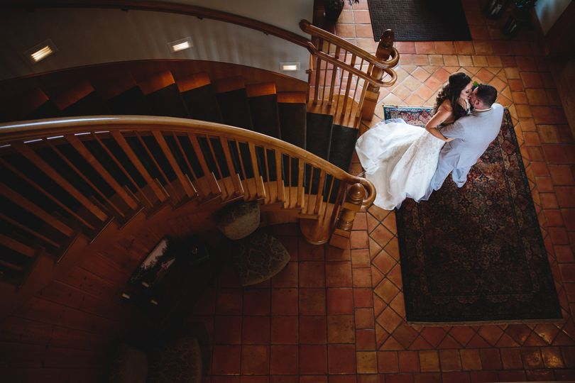 "Descend our grand staircase for a romantic ""first look."""