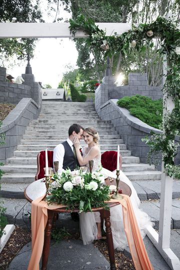 Table by the stone staircase