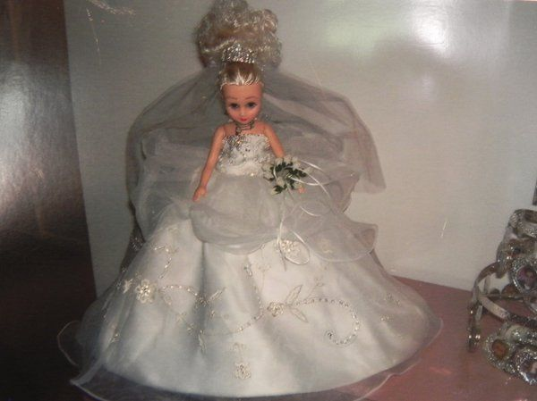 Custom bridal doll to simulate the bride's gown.