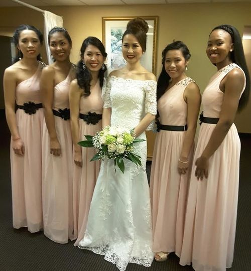 Peach dresses with black sashes