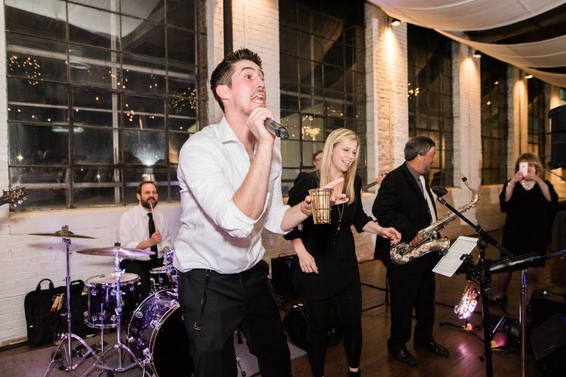 Groom singing with the band!