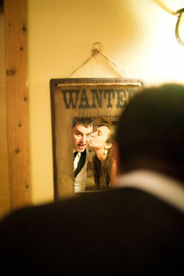 Reflection of newlyweds kissing