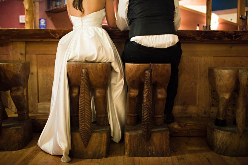 Newlyweds on animal chairs