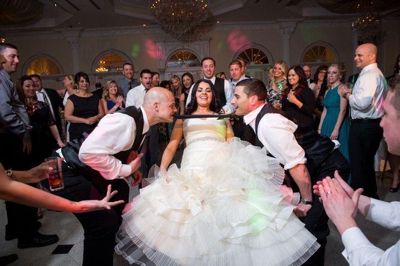 Bride and bridal party dancing