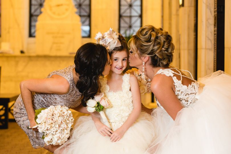 Bride with her flower girl and bridesmaid