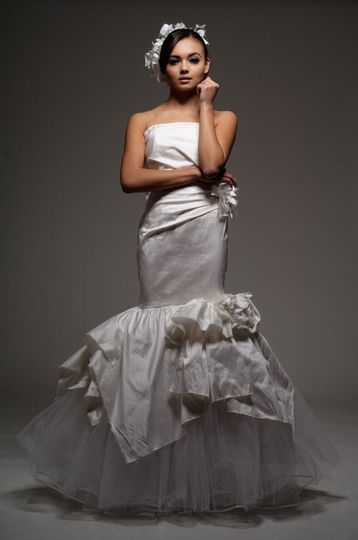 Calixto   Silk Shantung, strapless, mermaid gown with asymmetricaccents and raw edge trim & flowers....