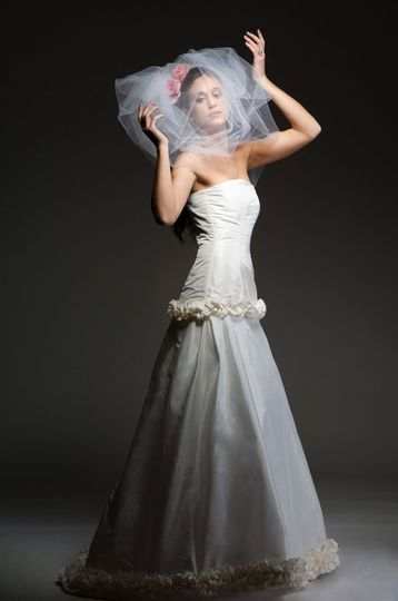 Claudia  Silk taffeta, strapless, a-line gown with ruffle detail, optional corset back