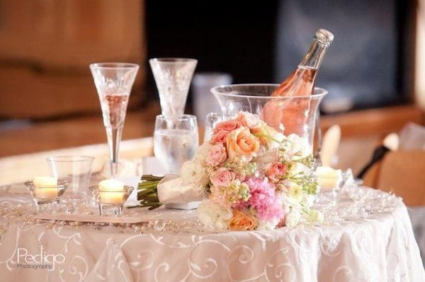 Bouquet and Champagne bottle with glasses