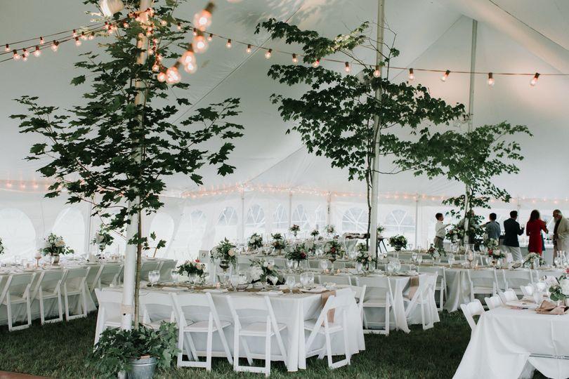 Inside of high peak pole tent wedding with bistro lighting