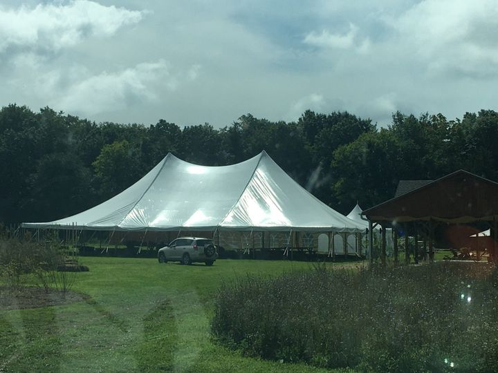 60x90 high peak eureka.... 5400 square ft with only two center poles!