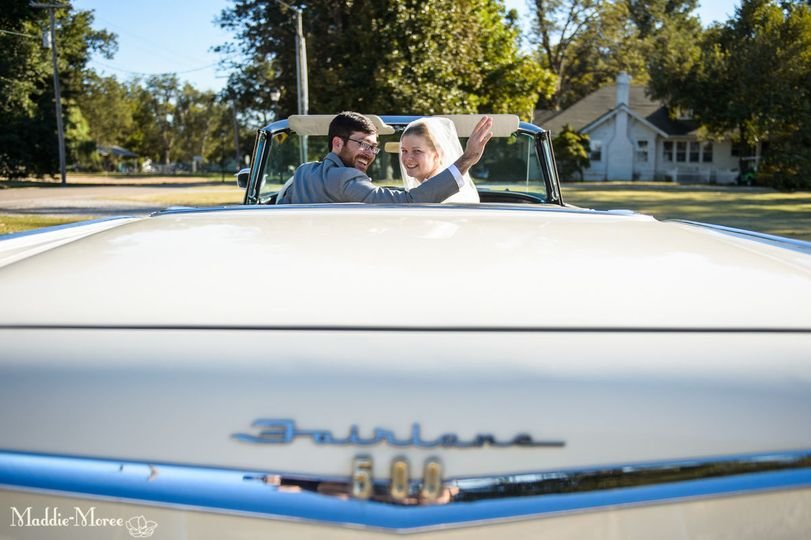 The newlyweds inside the car