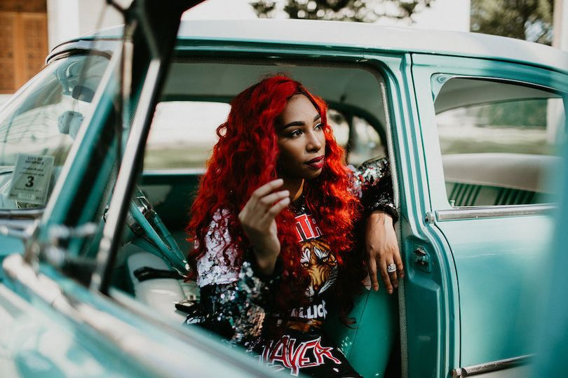 Red hair and blue car