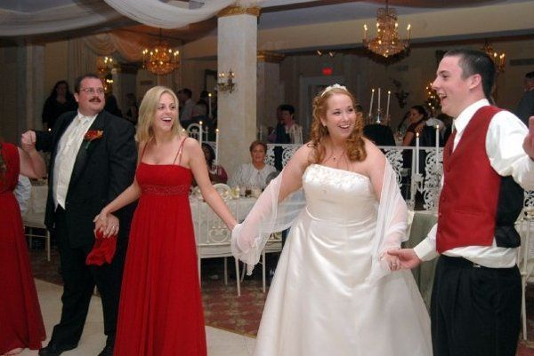 1519502c97bbd36c 1256313749099 wedding9