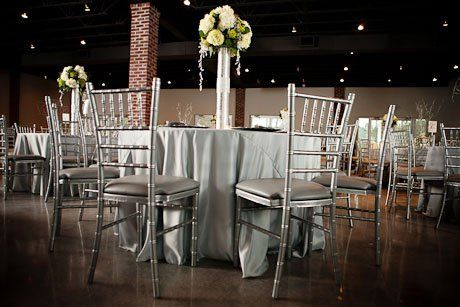 Silver chairs and raised floral centerpiece