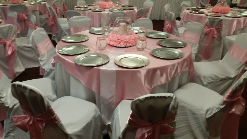 All Occasions pink and white theme table setup