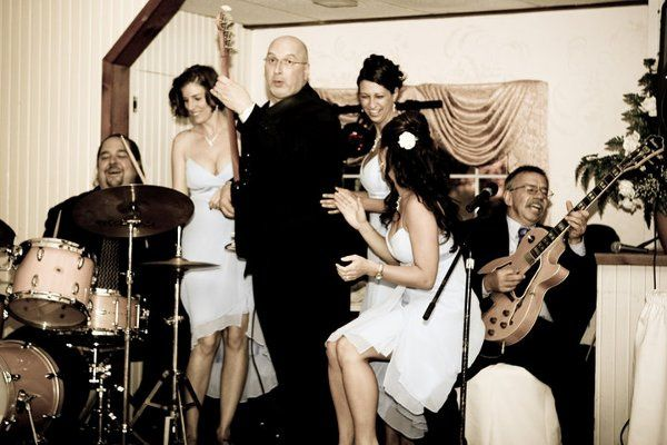 Cipriano Productions playing music together with the bridesmaids.