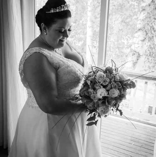 Bride by the window with her bouquet