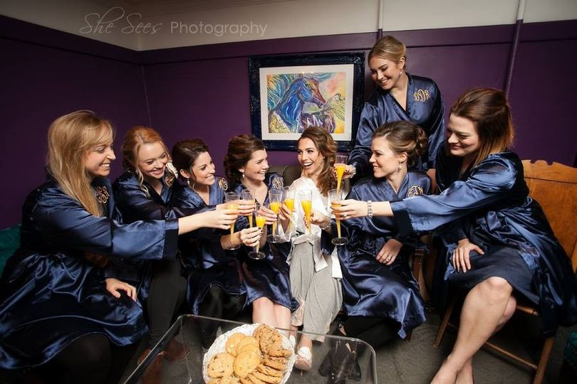 Bridal party toast in their robes