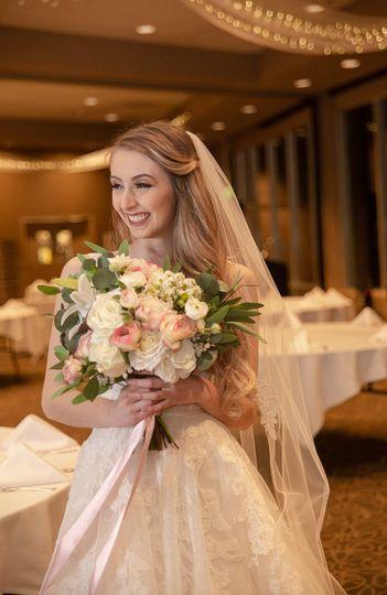 Happy bride in ballroom