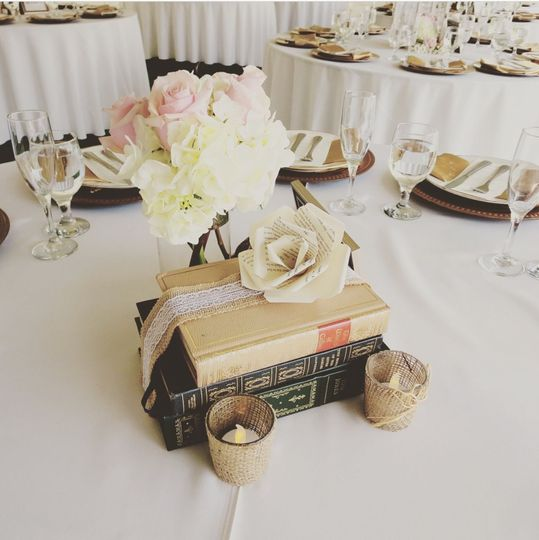 Book stack and floral centerpiece