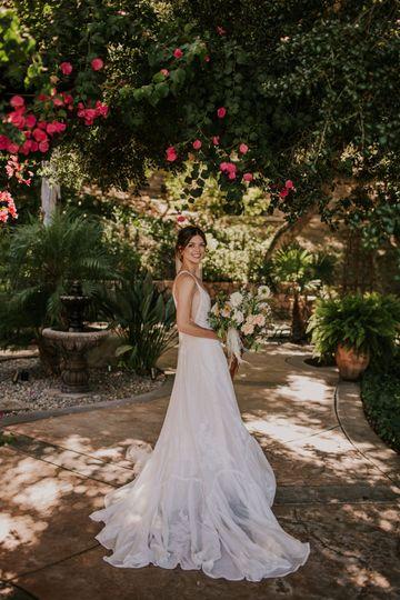 Bride standing under trees