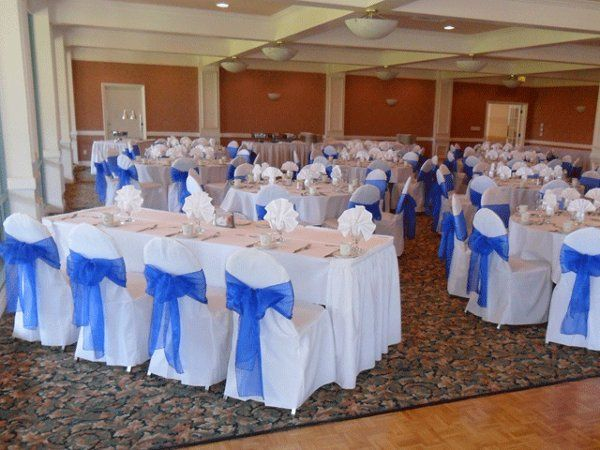 White chair covers with Blue organza bows. Head table.