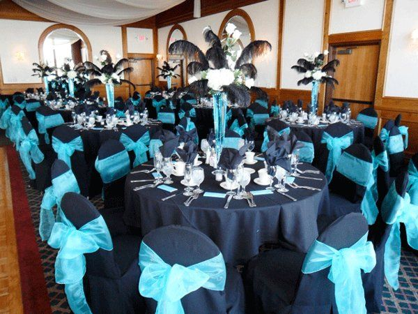 Black chair covers with Tiffany Blue organza bows.