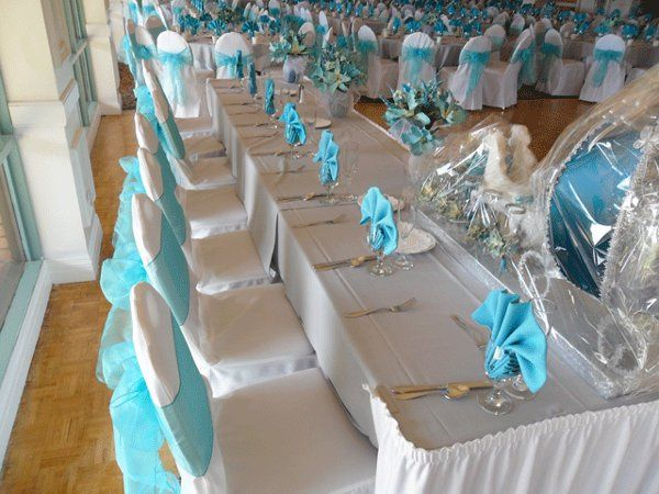 White chair covers with Tiffany Blue organza bows. Head table.