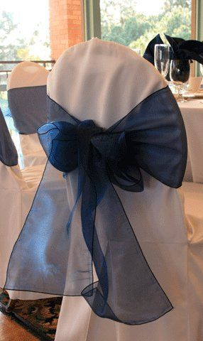 White chair cover with Navy Blue organza bow.